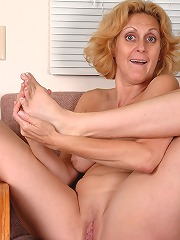 Blonde milf plays with her..